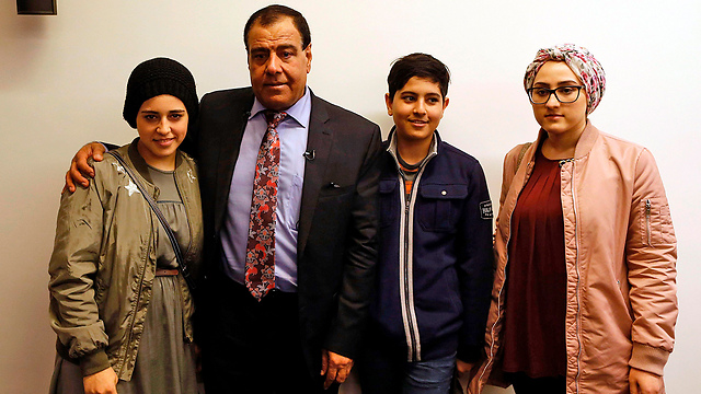Dr. Abuelaish with members of his family (Photo: AFP)