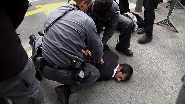 A detained Haredi protestor (Photo: Eli Mandelbaum)