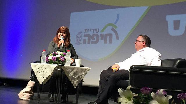 Bitan (R) being interviewed at the event by journalist Rina Matzliach