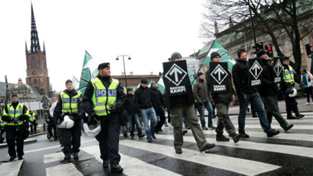 Members of the Nordic Resistance Movement march in Sweden