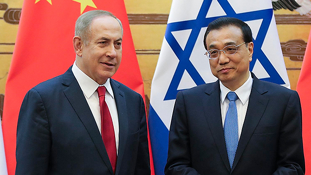 Netanyahu (L) and Li (Photo: EPA)