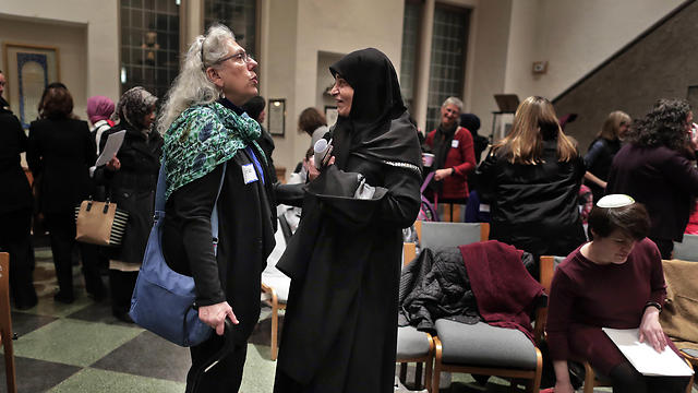 Members of the Sisterhood Salaam Shalom talk after a unity vigil held at the Jewish Theological Seminary in New York (Photo: AP)