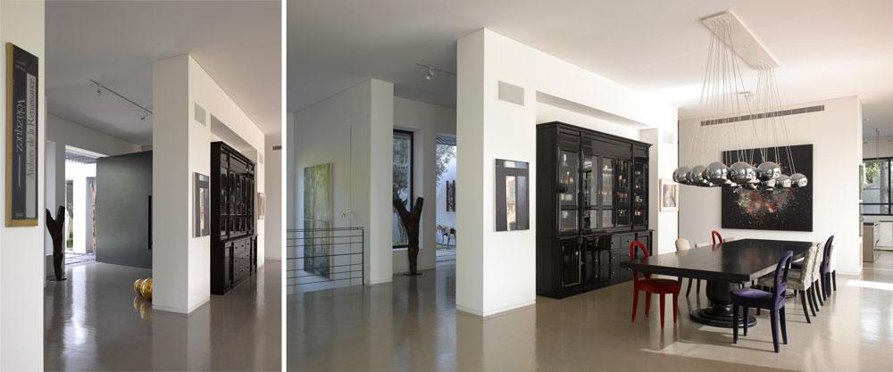דלת הכניסה הרחבה והשחורה נפתחת אל קיר שמסתיר את פינת האוכל. רצפת הבית חופתה בטדלק מוחלק בצבע בטון, ובעיצוב הפנים שולטת פלטת צבעי בהירים, עם הרבה חאקי ולבן (צילום: עמית גרון )