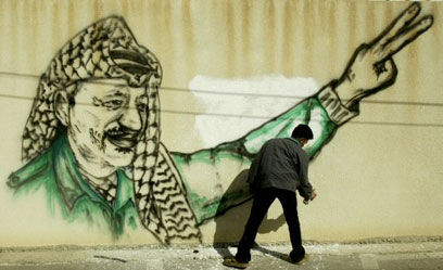 Graffiti in memory of Arafat in West Bank (Photo: Reuters)