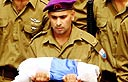 Soldier carrying Israeli flag at Eldad Regev's funeral (Photo: Hagai Aharon)