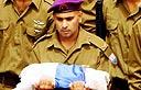 Soldier carrying Israeli flag at Eldad Regev's funeral (Photo: Hagai Aharon)