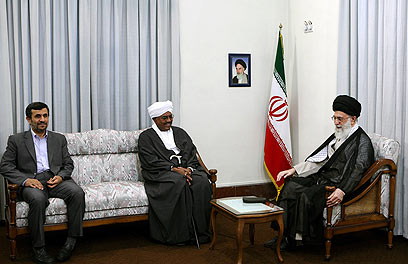 Sudan's President Omar al-Bashir (center) with Iran's Supreme Leader Ayatollah Khamenei (right) and then-Iranian president Ahmadinejad (Photo: AP)
