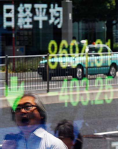 הבורסה בטוקיו. עולם עסקי עם חוקים משלו (צילום: רויטרס) (צילום: רויטרס)