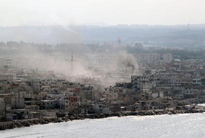 Syrians under fire (Photo: AFP)