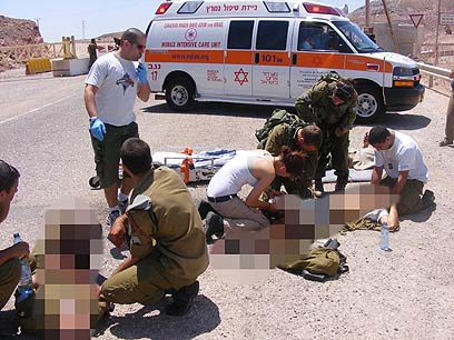 Victims treated at site of attack on bus (Photo: Yossi Ben)