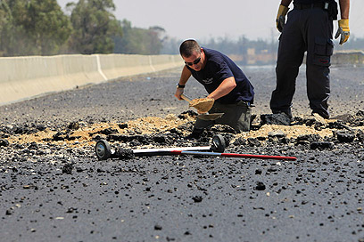 Qassam damage on Highway 35 (Photo: Tsafrir Abayov)