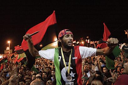 חוגגים את נפילתו הקרובה של קדאפי בבנגזי (צילום: AFP)