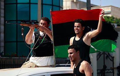 Rebels in Tripoli (Photo: Reuters)
