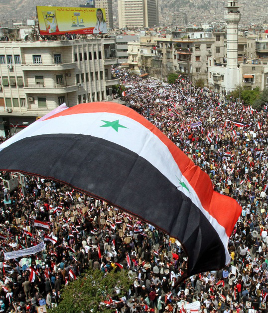 Syria flag in Damascus (Photo: AFP)
