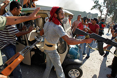 Rebels take over Gaddafi's golf cart (Photo: Reuters)