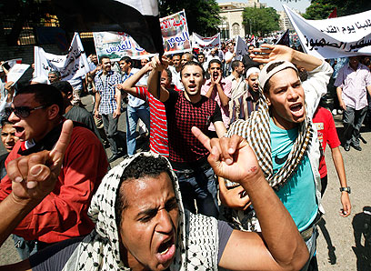 Protesters in Cairo, on Friday (Photo: AP)