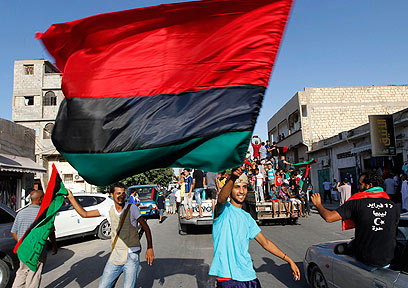Libyans celebrate Gaddafi's ouster (Photo: Reuters)