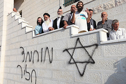Group near vandalized mosque (Photo: Ohad Zweigenberg)
