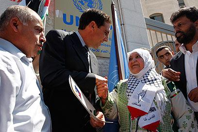 """לטיפה אבו-חמיד. כתבה למזכ""""ל האו""""ם (צילום: AP) (צילום: AP)"""