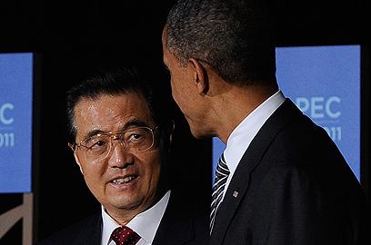 אובמה ונשיא סין הו ג'נטאו. המעצמה האסייתית מתנגדת לסנקציות (צילום: רויטרס) (צילום: רויטרס)