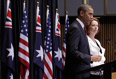 גילארד עם אובמה בביקורו באוסטרליה. יש להם מהמשותף (צילום: רויטרס) (צילום: רויטרס)