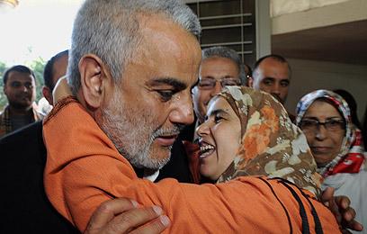 מנהיג מפלגת הצדק והפיתוח חוגג את נצחונו (צילום: AFP) (צילום: AFP)