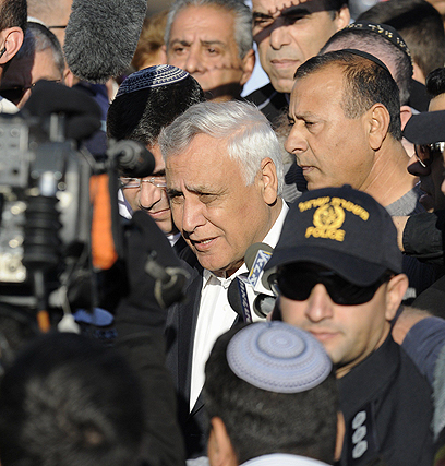 Katsav outside his home before heading to jail (Photo: AFP)