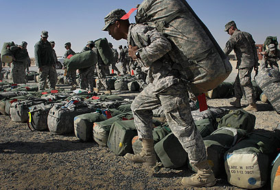 תחנת ביניים. חיילים אמריקנים בכוויית לפני שובם הביתה מעיראק (צילום: AFP) (צילום: AFP)