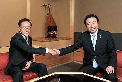 """""""פתרון עכשיו"""". נשיא דרום קוריאה לר""""מ יפן (צילום: AP Photo/Kyodo News) (צילום: AP Photo/Kyodo News)"""