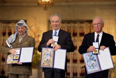 Arafat, Peres and Rabin receiving the Nobel Peace Prize (Photo: Sa'ar Yaakov, GPO)