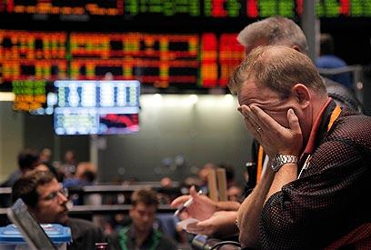 תוכנית התמריצים של הנשיא שיפרה זמנית את הכלכלה. וול סטריט בדאון (צילום: AP) (צילום: AP)