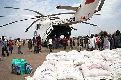 """מבצע הסיוע של האו""""ם (צילום: AFP) (צילום: AFP)"""