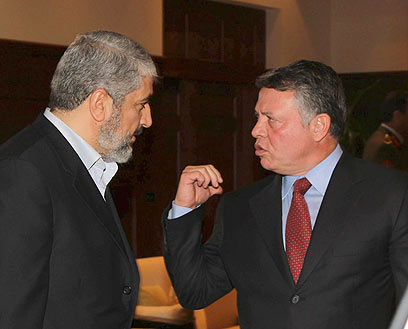 King Abdullah (R) with Khaled Mashaal in Amman (Photo: Reuters)