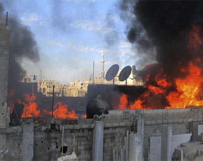 אש בחומס, בסוף החודש שעבר (צילום: AP) (צילום: AP)