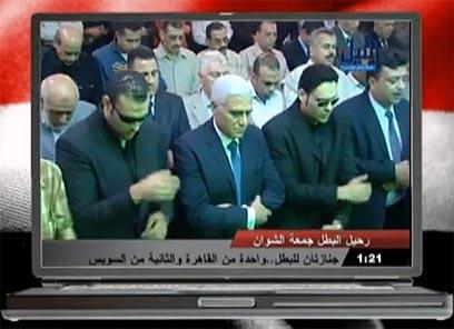 למואפי (בשיער הכסוף במרכז) תפקיד מרכזי בתמורות במצרים ()