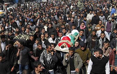 הלוויות ההרוגים בעזה. 12 יעדי טרור (צילום: AFP) (צילום: AFP)