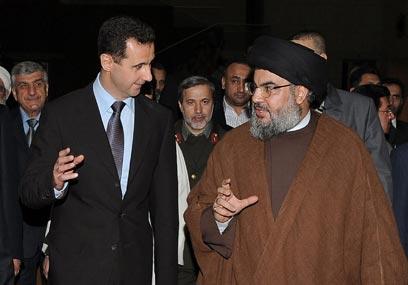 """""""המשטר הסורי שירת נאמנה את המטרה הפלסטינית"""". נסראללה ואסד (צילום: AP) (צילום: AP)"""