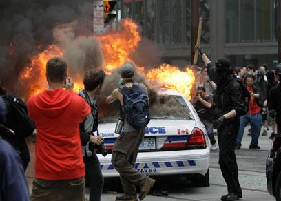 עיר יפה עם צד אפל. הפגנה בוונקובר (צילום ארכיון: AP) (צילום: AP) (צילום: AP)