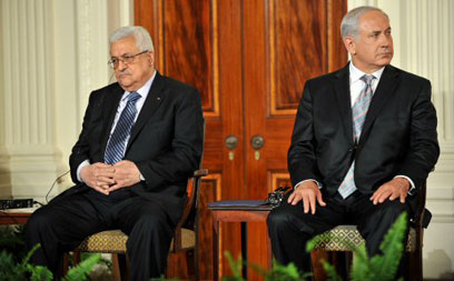 Prime Minister Benjamin Netanyahu and President Mahmoud Abbas (Photo: AFP)
