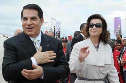"""""""לאחר הדחתם, התחיל המוסד להגביר פעילותו"""". בני הזוג בן עלי (צילום: AFP) (צילום: AFP)"""