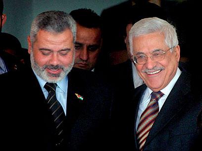 Palestinian President Mahmoud Abbas and Hamas leader Ismail Haniyeh (Photo: EPA)