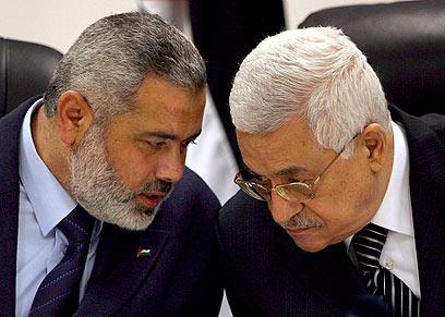 Haniyeh (R) with Abbas (L) (Photo: EPA)
