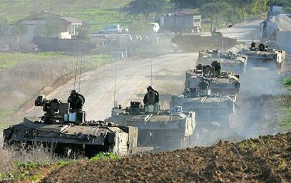 """ב""""עופרת יצוקה"""" הייתה כניסה קרקעית. טנקים של צה""""ל ב-2009 (צילום: AFP)"""
