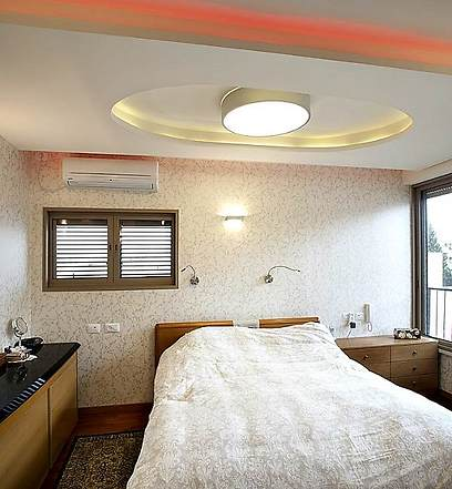אוירה של מלון בוטיק. חדר השינה (צילום: בנימין אדם)