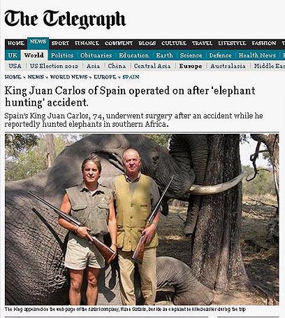 """מלך ספרד הגאה ליד פיל במסע ציד. מתוך """"הטלגרף"""" הבריטי ()"""