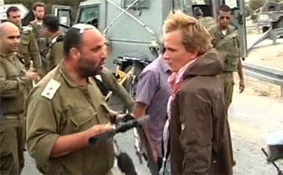 """""""חבר ומפקד ערכי ומוסרי"""". סא""""ל אייזנר במהלך העימות (צילום: AFP) (צילום: AFP)"""