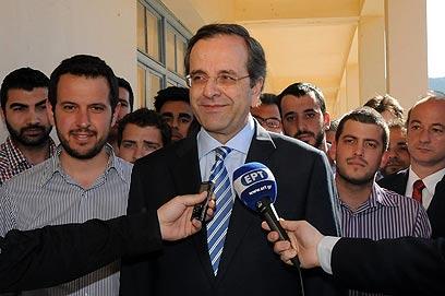 """מנהיג """"דמוקרטיה חדשה"""", אנטוניס סמאראס (צילום: AFP PHOTO / WILLY ANTONIOU) (צילום: AFP PHOTO / WILLY ANTONIOU)"""