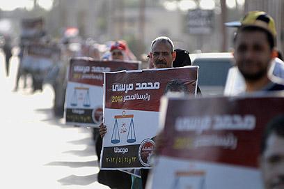 תומכים בעד מורסי (צילום: AFP) (צילום: AFP)