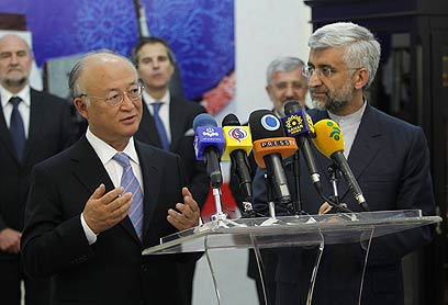 """ראש סבא""""א ונציג איראן לשיחות הגרעין (צילום: AP) (צילום: AP)"""