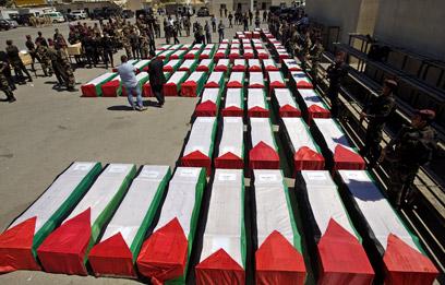 הארונות נעטפו בדגלי פלסטין. כל הבכירים הגיעו לטקס (צילום: AFP) (צילום: AFP)